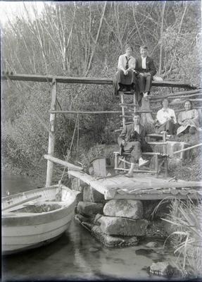 Unidentified group with boat and landing platform
