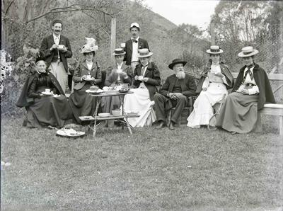 Reverend Algernon Gifford and family. Tea on the lawn.
