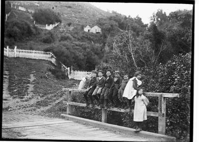Unidentified children on bridge