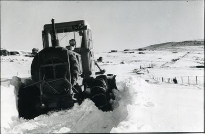 Grader stuck in deep snow.