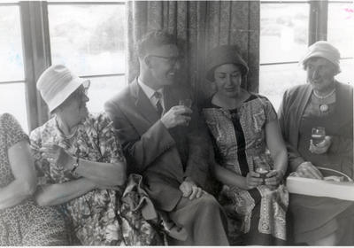 Three women and N T Farrell in conversation.