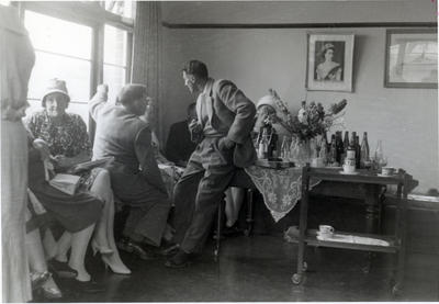 A group including two men and several women in conversation.