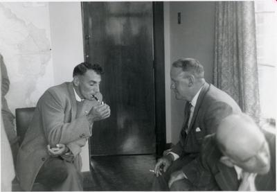 Three men at a meeting.