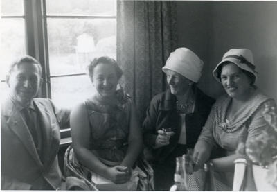 Three women and one man seated.