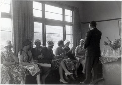 A group of women seated at an afternoon function.