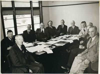 Members of the Waihemo County Council seated inside the  council offices.