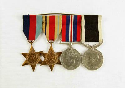 Set of WWII Medals: 1939-1945 Star Medal, Africa Star, War Medal 1939-1945, New Zealand War Service Medal.