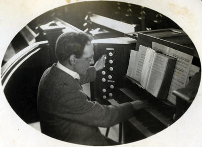 Man playing an organ