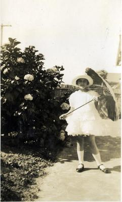 Girl  in a garden, Coquet Street Oamaru; 2014/43.1.85