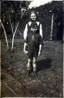 Girl and boy in a garden; 2014/43.1.108