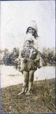 Girl and boy in a garden; 2014/43.1.111