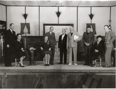 "Performers on stage in ""Outward Bound"""