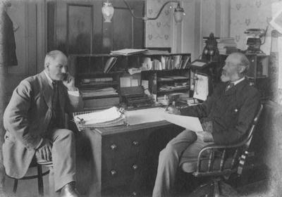 S Cumming, Chief Clerk, left,  W W Beswick, Postmaster, Oamaru Post Office; P0027.51.4