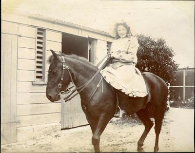 Girl on horseback; 2014/43.2.77