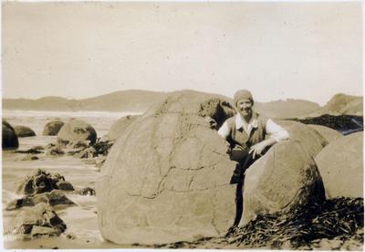 Woman at Moeraki Boulders; 2014/43.2.119