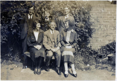 Alfred Leslie with people in a garden.; 2014/43.2.130