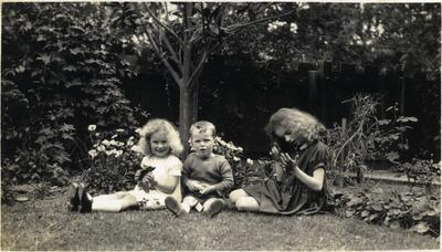 Three children in a garden