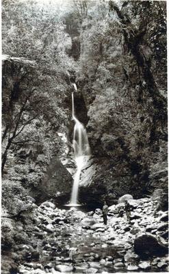 Man and woman at a waterfall