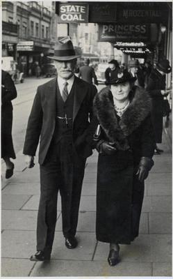 Man and woman walking on Manners Street, Wellington.; Valerie Studios (Wellington); 2014/43.2.154