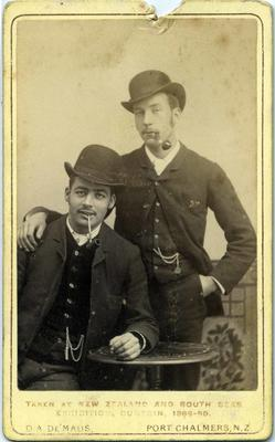 Studio portrait unidentified men. New Zealand and South Seas Exhibition Dunedin.