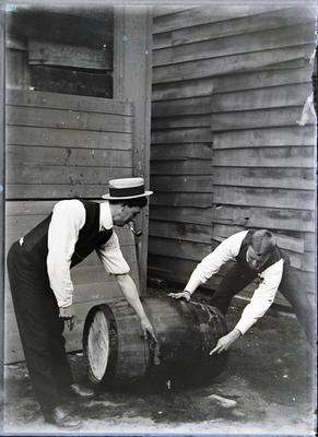 Unidentified men with barrel