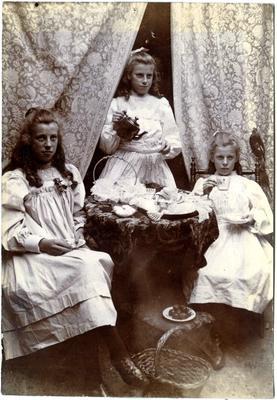 Three girls having tea; 2017/002.194