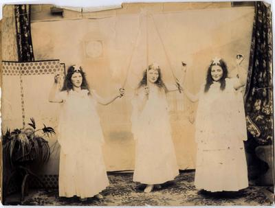 Three young women dressed as angels.