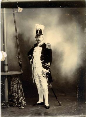 A man in Victorian naval  uniform.