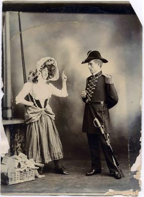 A young man in Victorian naval costume and a young woman in peasant costume.