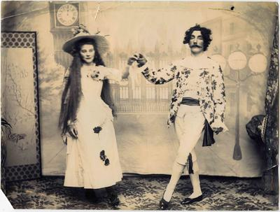 A theatrical couple in elaborate Victorian mid-European costume
