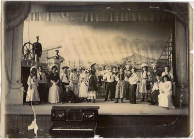 A seafaring scene with twenty-two chorus members. The men dressed as sailors the women in Victorian style costume