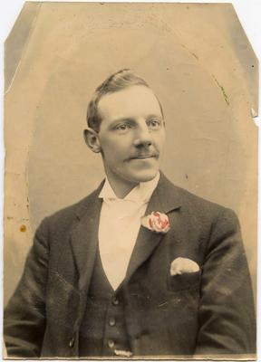 A head and shoulders photo of a young man in formal attire.