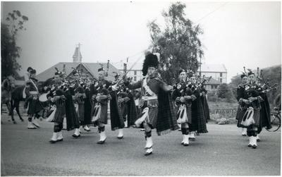 Members of a Highland Pipe Band on Severn Street
