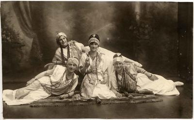 Four women in Middle Eastern costume.