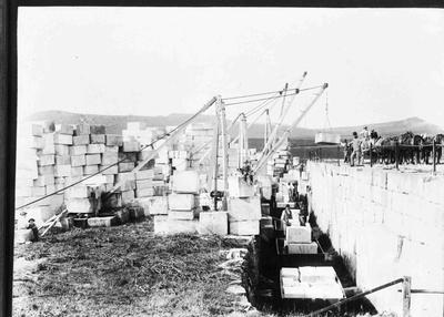 Photograph of Oamaru stone being loaded at One Tree Farm, Totara