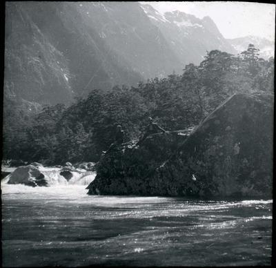 Two men beside a river