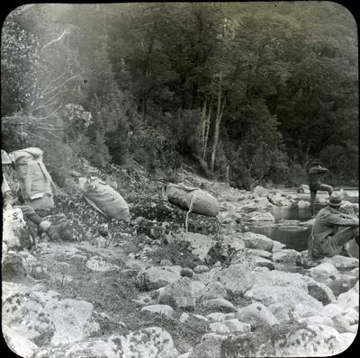 Three men at the Worsley River