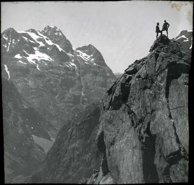 Two men on a mountain peak