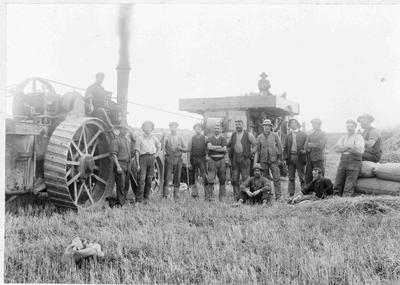 Group and Threshing Mill unidentified, c.1900. Traction engine