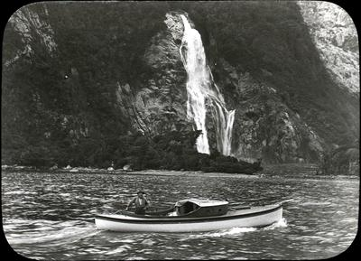 Man in a boat at Bowen Falls.