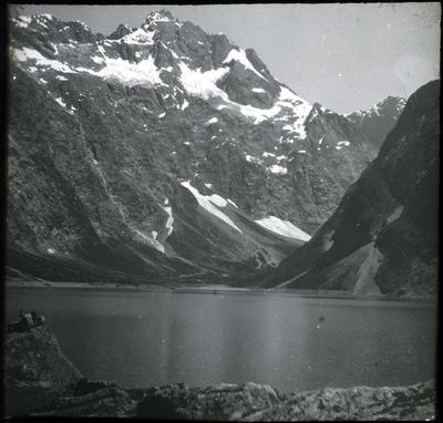 Men beside a mountain lake; 2019/192.2.95