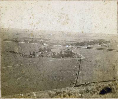 View over farm land, location unidentified.
