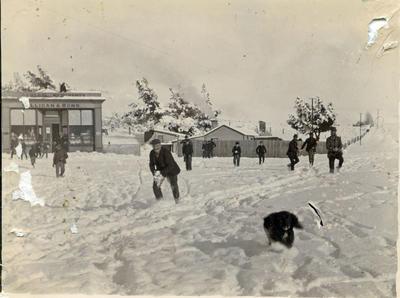 Men in the snow. Milligan and Bond General Merchants, Ngapara.
