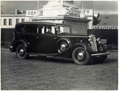 Driver and car during the visit of the Duke of Gloucester to Dunedin.