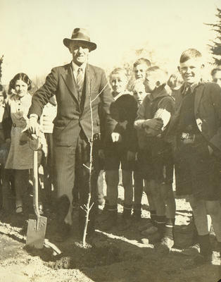 John C. Kirkness, planting tree celebrating Centennial of New Zealand