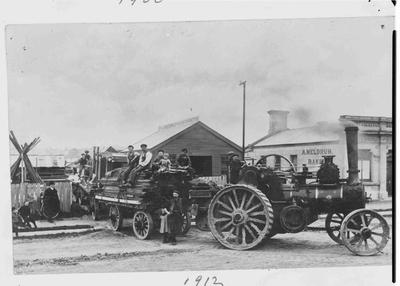Traction engine pulling builder's materials.; 744P