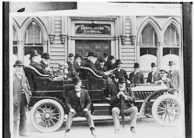 Unidentified group in a Motor Vehicle outside Legislative Council c.1908.