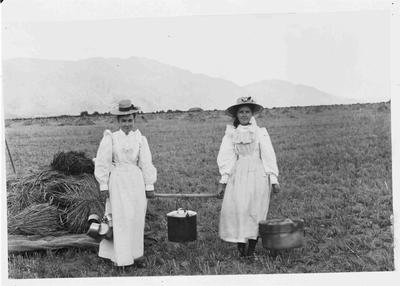 Unidentified females carrying pots in Hayfield c.1900.