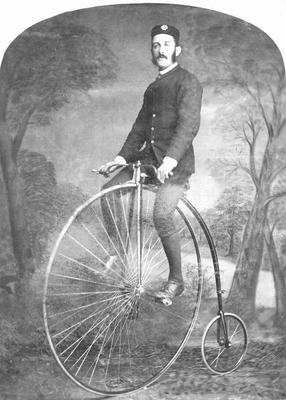 Frank J Forbes on a penny farthing bicycle