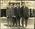 Men standing on a city street